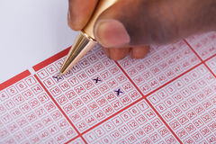 Person Marking Number On Lottery Ticket Royalty Free Stock Photography