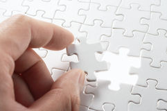 A person matching the last puzzle pieces. Stock Photos