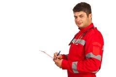 Person med paramedicinsk utbildning som tar anmärkningar Royaltyfri Bild