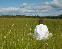 Person is meditation far away from civilization Stock Photos