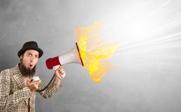 Paint splash with person and megaphone royalty free stock images
