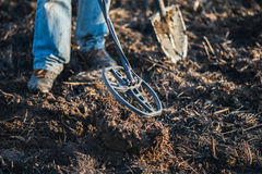 A person with a metal detector in a field, search for coins, hobbies. Recreation. Hobby. Ukraine Royalty Free Stock Image