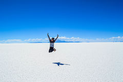 Person in Middle of Snow Field Jump Shot Photography during Day Time Royalty Free Stock Photo