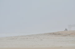 Person on misty beach. Person sat on misty or foggy St. Augustine beach, Florida, U.S.A Royalty Free Stock Photo