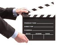 Person mit einem Filmklatschen Stockbilder