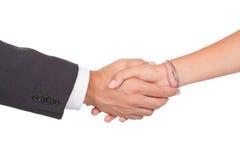 Person mit zwei Geschäften, die Hände auf einem Abkommen rüttelt Stockfotografie