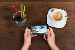 Person With Mobile Phone Showing Video Stock Photos