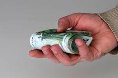 Person with money in hand and white backround.  stock photo