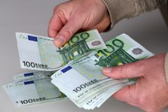 Person with money in hand and white backround.  stock photos