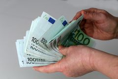 Person with money in hand and white backround.  royalty free stock photo