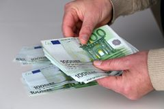 Person with money in hand and white backround.  royalty free stock photos