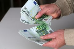 Person with money in hand and white backround.  royalty free stock images