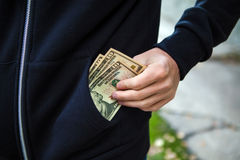Person with the Money. Person hold the Money in the Pocket on the Street closeup Stock Image