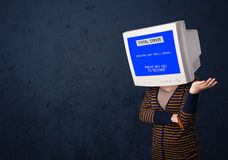 Person with a monitor head and fatal error blue screen on the di Stock Image