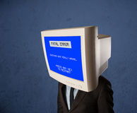Person with a monitor head and fatal error blue screen on the di Royalty Free Stock Images
