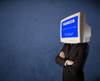 Person with a monitor head and fatal error blue screen on the di Stock Photo
