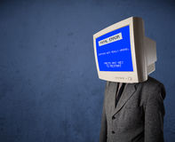 Person with a monitor head and fatal error blue screen on the di Royalty Free Stock Photography