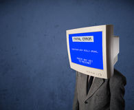 Person with a monitor head and fatal error blue screen on the di Stock Photos