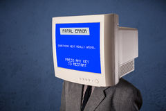 Person with a monitor head and fatal error blue screen Royalty Free Stock Photography