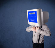 Person with a monitor head and fatal error blue screen Stock Images