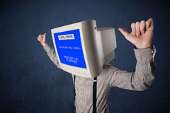 Person with a monitor head and fatal error blue screen. On the display stock photography
