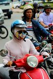 Moped, Hi Chi Minh City, Vietnam. Person and moped in traffic in Ho Chi Minh City, Vietnam Royalty Free Stock Image