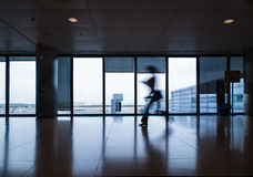 Person in motion in an airport Royalty Free Stock Images