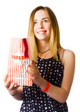 Person at movie cinema with popcorn bag Stock Photo