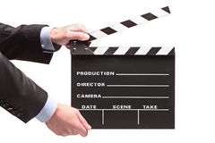 Person with a movie clap Stock Images