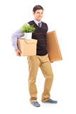 Person with moving box and other stuff Stock Image