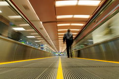 Person on moving travelator Stock Images
