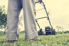 Person mowing a lawn Stock Photography