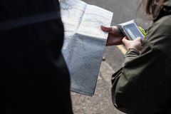 Person navigating with a map and a phone. Hikers navigating with a map in Dartmoor National Park Royalty Free Stock Image