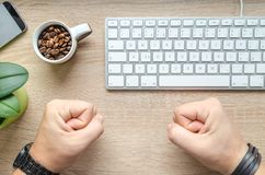 Person Near Apple Keyboard and Cup With Coffee Beans stock photography