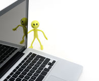 Person with notebook. Smiling person (the doll from plastic arts) with notebook. Conceptual photo Stock Photo