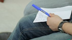 Person with notebook and pen. Person sitting with notebook and pen stock video