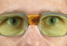 Person in old bad spectacles with poor eyesight Royalty Free Stock Photography