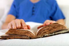 Person with the Old Book Stock Images