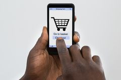 Person Online Shopping On Cellphone Royalty Free Stock Photo