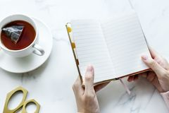 Person Opened a Book Near White Ceramic Cup Filled With Coffee Royalty Free Stock Image