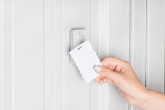 Person opening door with electronic card Royalty Free Stock Photo