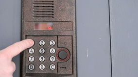 Person opening door using a numeric code of access stock video
