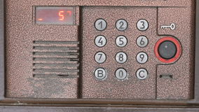Person opening door using a numeric code of access stock video footage