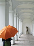 Person with a orange umbrella standing Stock Photography