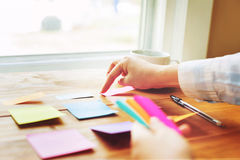Person organizing things at a desk Royalty Free Stock Photos