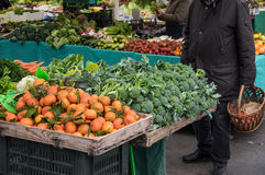 Person at outdoor market. Costumer picking vegetables at local outdoor market in Ljubljana, Slovenia Stock Photos