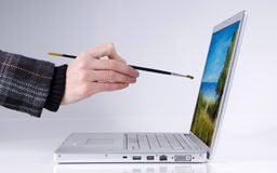Person painting on laptop Royalty Free Stock Image