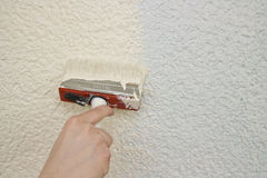 Person painting wall Stock Photo