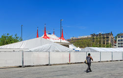 Person passing along the fence of Circus Knie in Zurich, Switzer Royalty Free Stock Photo