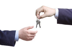 Person passing door keys Stock Images